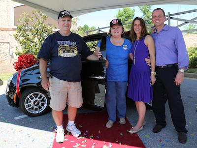 Photo Credit: Pitter Goughnour; Mary Arthur of Eatonton (center) is congratulated by friend Ronnie Hamm (left) and Drs. Patti and David Bradley (right) after being announced winner of the Lake Oconee Dentistry FIAT giveaway.