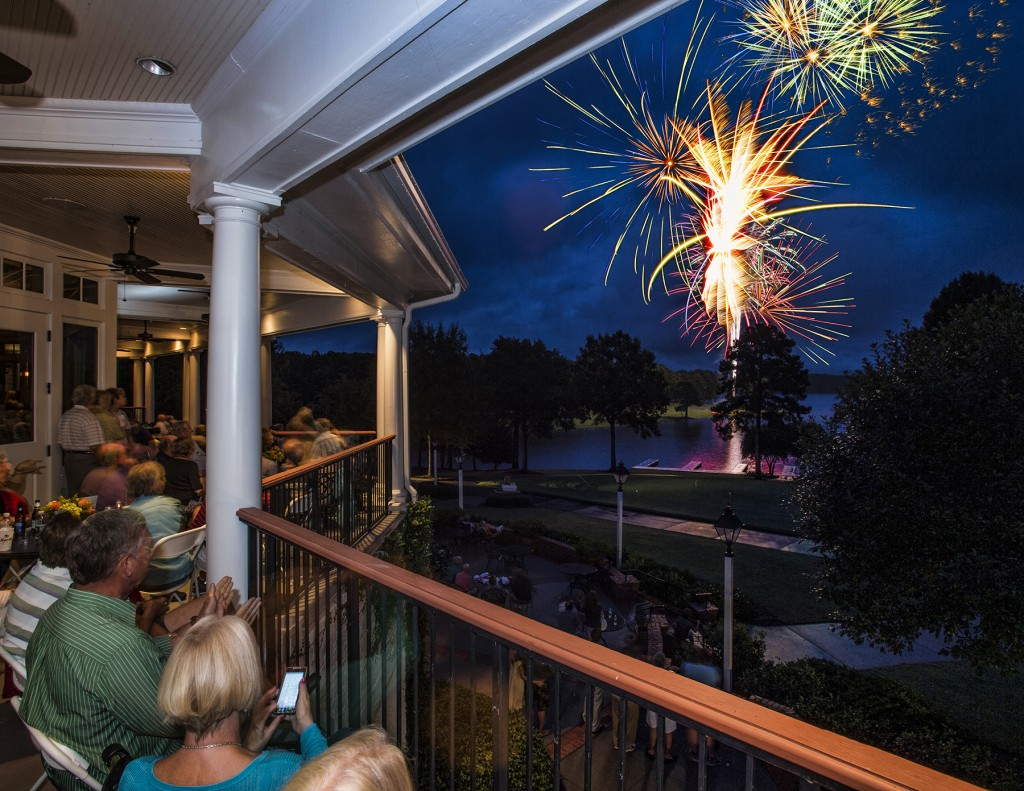 Reynolds Plantation members watch the fireworks over Lake Oconee from the Great Waters Clubhouse.