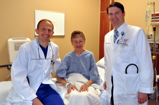 Louise Condron, center, recipient of Athens' first S-ICD implantable cardiac defibrillator, poses with the implanting cardiologist John Layher, M.D., left, and her primary cardiologist, Clay Chappell, M.D., right, prior to her procedure Monday.