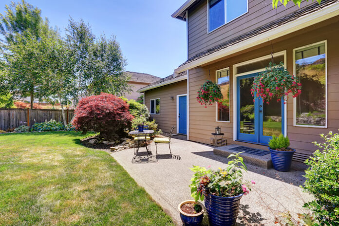 Backyard garden with patio area and beautiful landscape. Northwest, USA